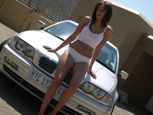 BMW with model, by Flickr user BenediktSebastian