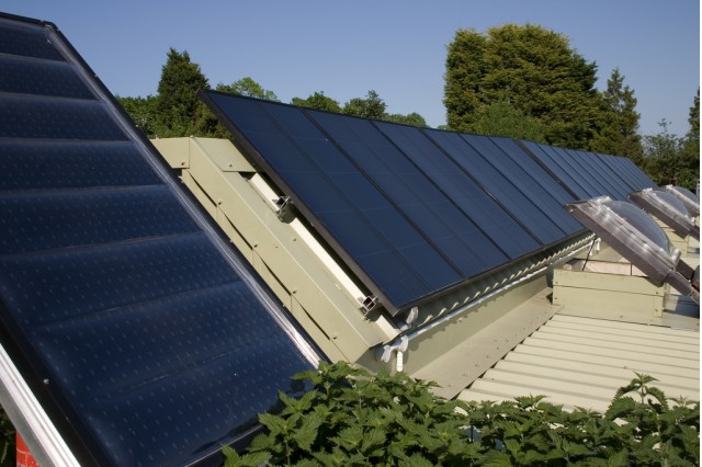 Brighton Earthship Solar Panels by Flickr user Dominic's Pics