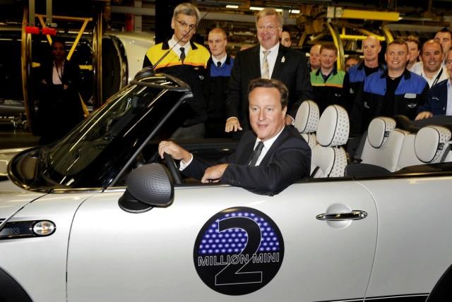 British Prime Minister David Cameron driving the two-millionth MINI produced. Image: MINI
