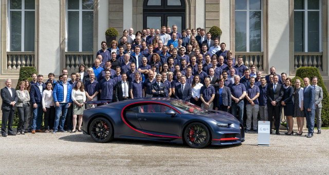 Bugatti staff and the 100th Chiron at Bugatti's headquarters in Molsheim, France