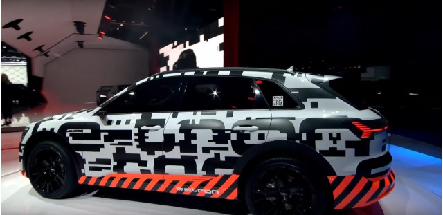 Camouflaged 2019 Audi e-tron electric SUV on stage at 2018 Geneva auto show