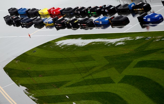Cars covered in hopes of starting the 54th Daytona 500 - NASCAR photo