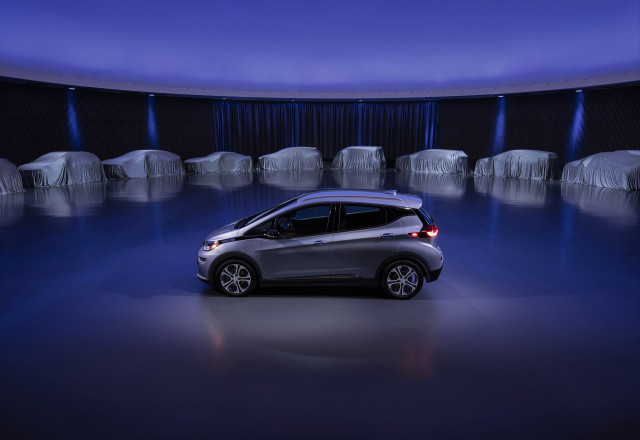 General Motors promises more electric vehicles, paid for by SUVs