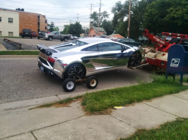 Chrome Lamborghini Gallardo towed from accident scene. Photo by Sheldon Little.
