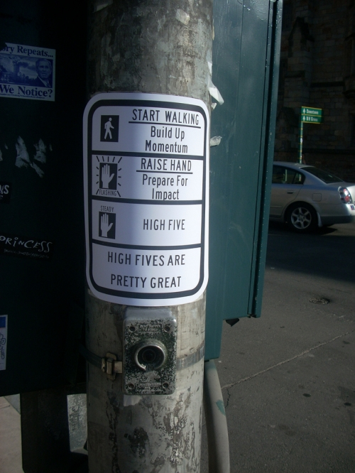 Crosswalk sign hack by Ryan Laughlin