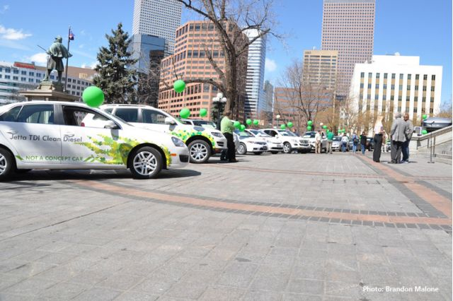 Crowd of people around the Volkswagen Jetta and Touareg 2 TDI and Toyota Prius and Mercedes CDI in the background at the Denver Green Car Parade.