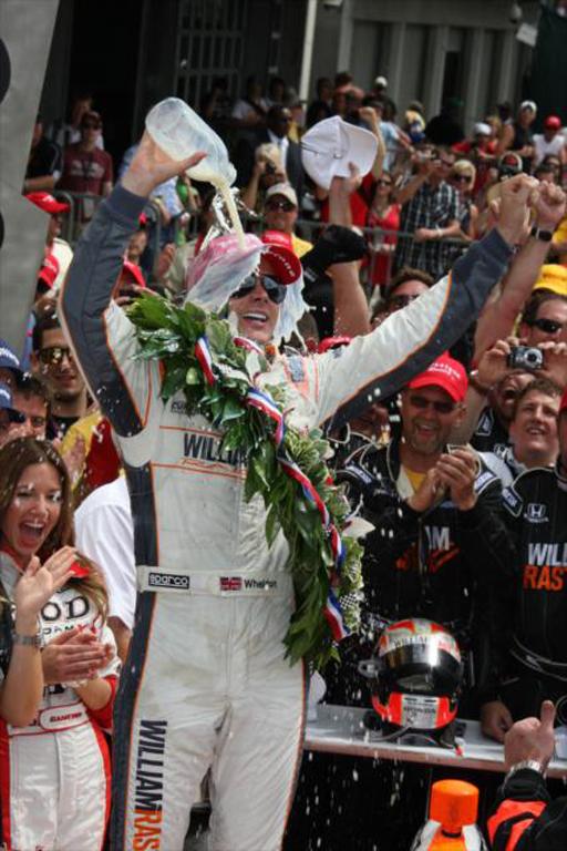 Dan Wheldon'sVictory Lane celebration at 2011 Indy 500 - Indianapolis MOtor Speedway photo
