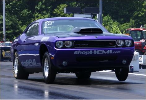 Daniels wheels her Dodge Challenger down the drag strip. Image courtesy of Tiff Daniels.