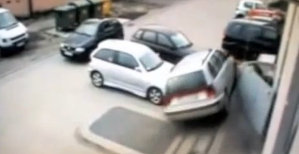 Driver mistakes gas for brake while attempting to park