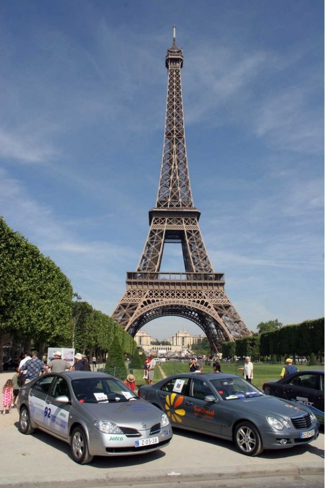 Eiffel Tower and green cars