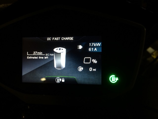 Dashboard of Energica Eva electric motorcycle while fast charging during test ride, SF Bay Area