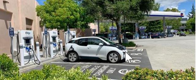 Chevrolet Bolt EV charging at EVgo fast chargers at Chevron station, Menlo Park, California