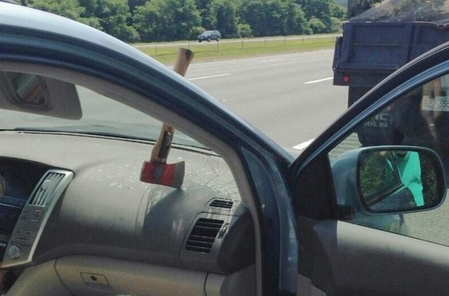 Flying axe embedded in dash of unfortunate, but lucky, car
