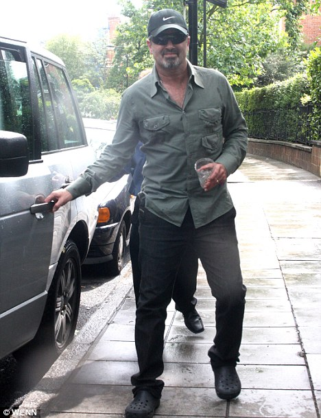 George Michael with a cocktail