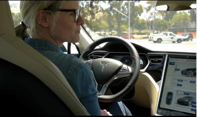 GigaOm's Katie Fehrenbacher behind the wheel of a 2012 Tesla Model S (video screen capture)