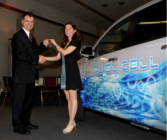 Charles Freese, executive director of GM Fuel Cell Activities, hands off the keys for a long-term loan of a Chevy fuel cell vehicle to Los Angeles biologist Stephanie White on Tuesday in Burbank, Calif. White, a fuel cell advocate and participant in the Project Driveway demonstration fleet of Chevrolet Equinox Fuel Cell Electric Vehicles, will drive the vehicle for the next six months.