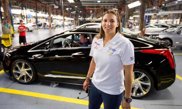 IndyCar driver Simona de Silvestro at the 2014 Cadillac ELR production line
