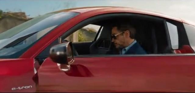 Iron Man Tony Stark (Robert Downey Jr.) in the Audi R8 e-tron
