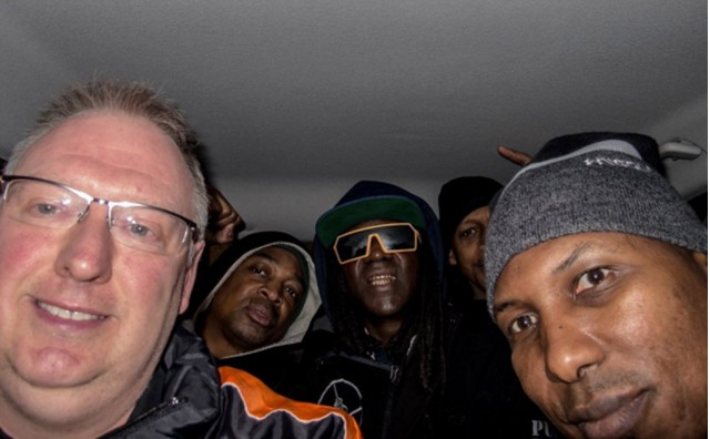 Kevin Wells with Public Enemy in the back of his Ford Focus