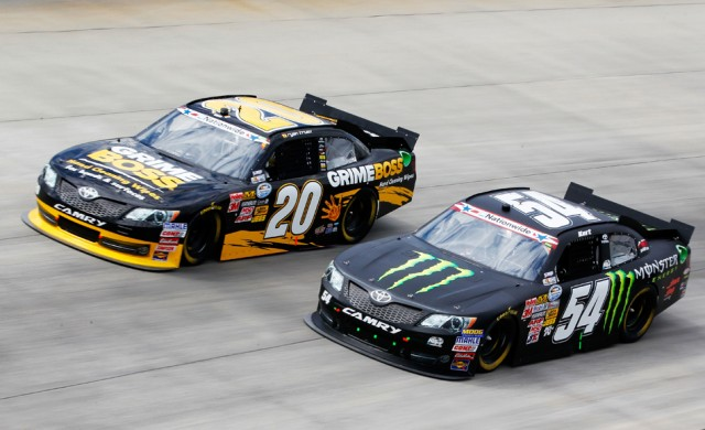 Kurt Busch (No. 54) races wtih Ryan Truex at Dover - NASCAR photo