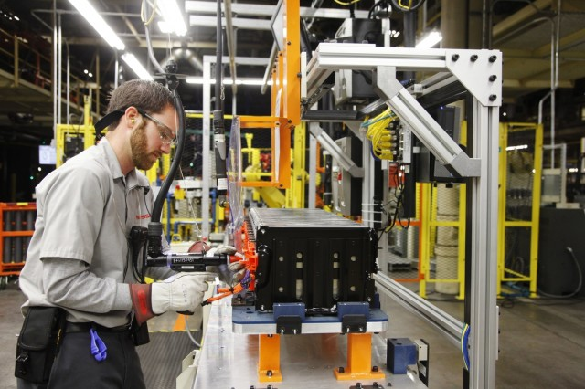 Technician attaches bus-bars to lithium-ion cell stack assembly at plant in Smyrna, Tennessee
