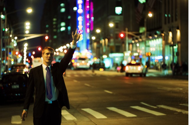 Man trying to hail a taxi (via Flickr user Linh Nguyen)