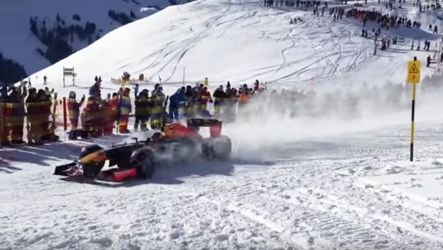 Max Verstappen pilots a Red Bull Racing F1 car in the Austrian alps