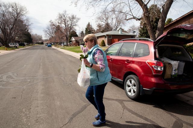 Kathy Kreidler delivers meals in south suburban Denver on April 1, 2020.