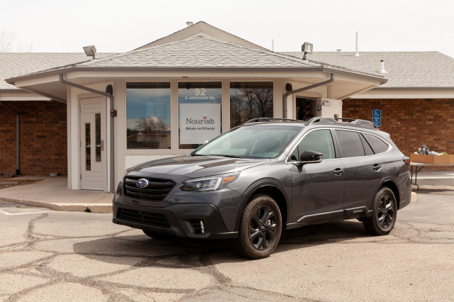 A 2020 Subaru Outback is shown outside of Nourish Meals on Wheels in Englewood, Colorado.