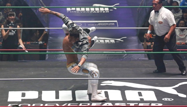 Mercedes AMG's Lewis Hamilton takes part in an exhibition wrestling match prior to the Mexican GP