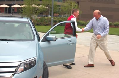 Microsoft CEO Steve Ballmer takes delivery of a 2010 Fusion Hybrid from Ford CEO Alan Mulally