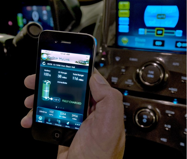 OnStar engineer demonstrates OnStar MyLink for mobile phone applications.