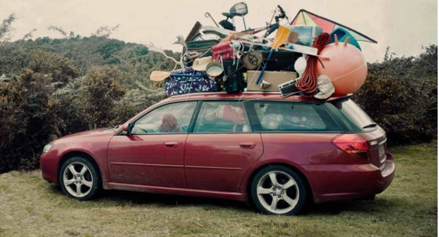 Overloaded Subaru Legacy with stuff on roof