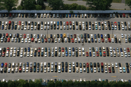 How Do You Park In Crowded Lots: Dive Head First, Or Back It Up?