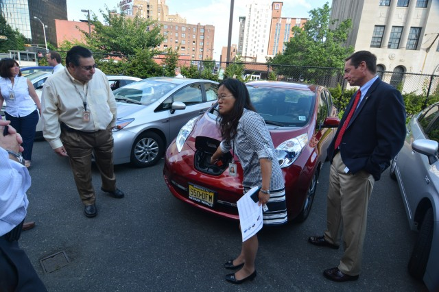 Plug-in electric cars at PSE+G facility in Newark, New Jersey