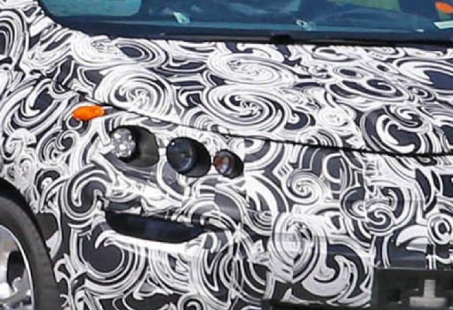 Portion of Chevrolet Bolt EV spy shot during testing, Autoblog, Jun 2015 [photographer Chris Doane]