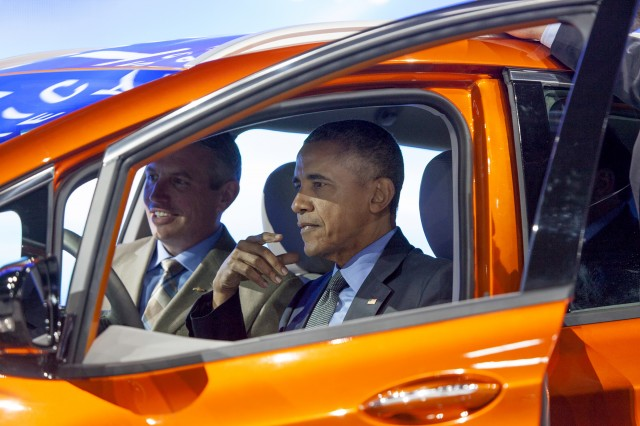 President Barack Obama sits in 2017 Chevrolet Bolt EV electric car at Detroit Auto Show, Jan 2016