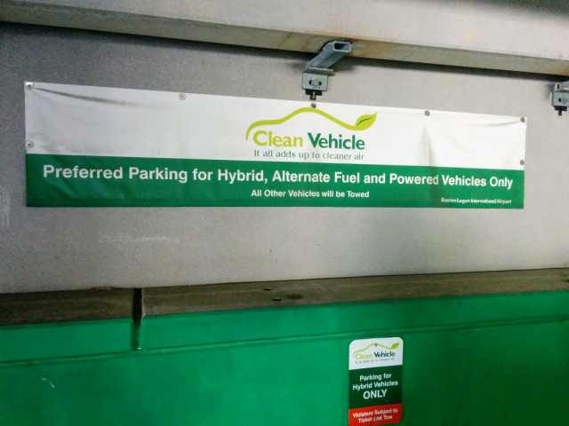 Previous sign at Boston Logan airport restricting green car parking to hybrids [CREDIT: John Briggs]