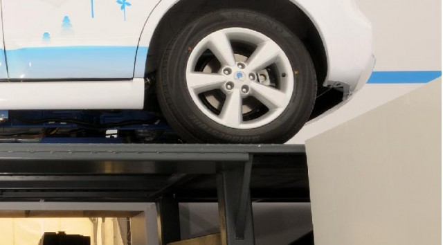 Prototype of adapted vehicle hoist to permit NuTankX gasoline-tank swapping