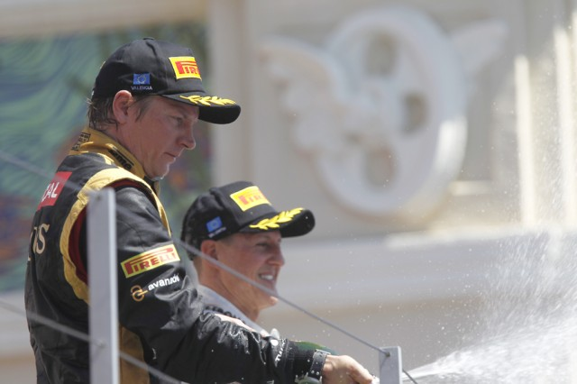 Raikkonen and Schumacher on Valencia podium - Lotus F1 team photo