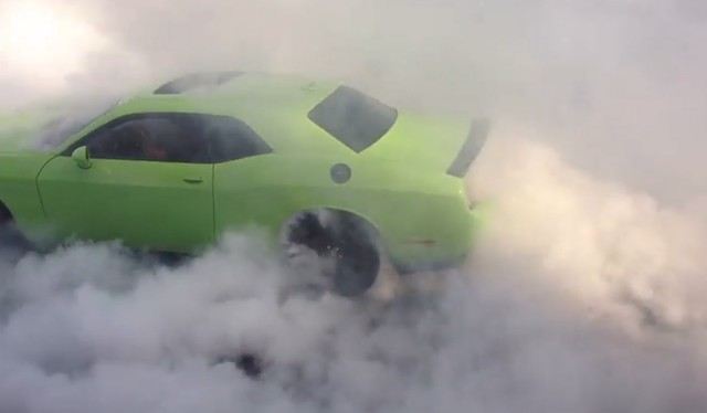 Ralph Gilles does a burnout in the 2015 Dodge Challenger SRT Hellcat