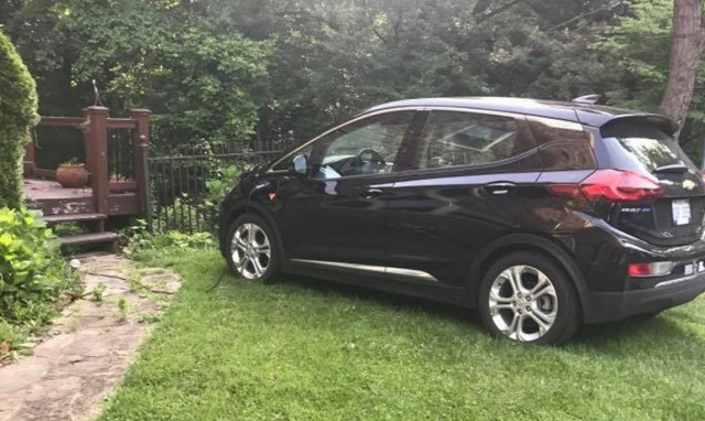 Reader David Edwards' Chevy Bolt EV, charing on a friend's lawn in Maryland