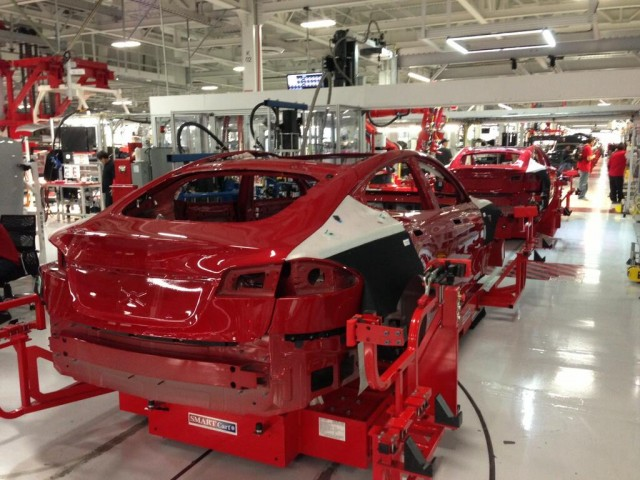 Red 2013 Tesla Model S cars roll down the production line (Photo: @elonmusk on Twitter)