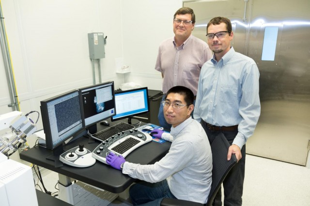 Researchers Yang Song (seated), Dale Hensley (center), Adam Rondinone [Oak Ridge National Lab]