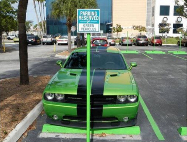 """Reserved parking for green vehicles."" Is that a green vehicle?"