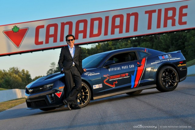 Ron Fellows poses with the Camaro ZL1 pace car to be auctioned