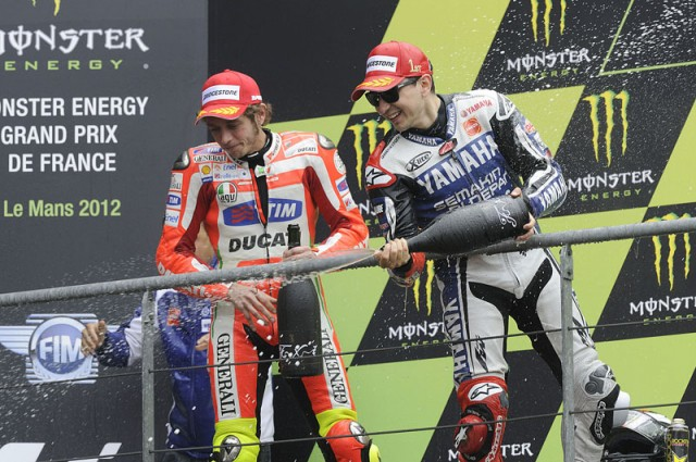 Rossi and Lorenzo celebrate on the Le Mans podium - Bridgestone photo