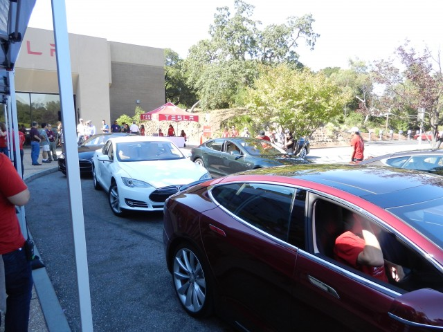 "Six 2012 Tesla Model S cars at ""Get Amped"" introductory drive event [photo: George Parrott]"