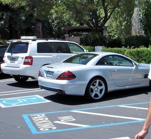Steve jobs back to parking benz sl illegally for Mercedes benz parking