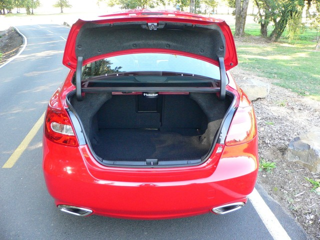 Trunk is surprisingly large, and hinges won't crush the top of your groceries.